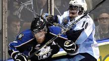 Mississauga St. Michael's Majors forward Brett Flemming hits Kootenay Ice forward Kevin King (L) during the second period of their round-robin Memorial Cup ice hockey game in Mississauga May 22, 2011. REUTERS/ Mike Cassese (MIKE CASSESE)