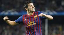 Barcelona David Villa celebrates after scoring against Viktoria Plzen's during their Champions League Group H soccer match at the Nou Camp stadium in Barcelona, October 19, 2011. (GUSTAU NACARINO/REUTERS)