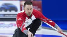Newfoundland and Labrador skip Brad Gushue delivers a rock as they play Team Canada in gold medal action at the Tim Hortons Brier curling championship at Mile One Centre in St. John's on March 12, 2017. (Andrew Vaughan/THE CANADIAN PRESS)