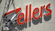 A workman installs a sign at the Zellers store on Thermos Rd., Toronto in this file photo. (Fernando Morales/The Globe and Mail)