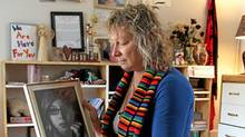 Donna Leslie looks a her daughter Loren's photo at her home in Vanderhoof. Leslie sits on a casket made for Loren, was signed by her friends in the comminity. Loren was cremated and here ashes are kept in Loren's Eeyore pillow bag. (David Mah/David Mah)