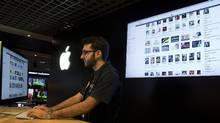An employee at an Apple store checks the iTunes store on a computer as he works in Sao Paulo, Brazil, Tuesday Dec. 13, 2011. Apple says it launched iTunes on Tuesday in Brazil and 15 other Latin American countries. (Andre Penner/Andre Penner/AP)