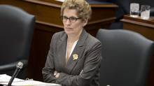 Ontario Premier Kathleen Wynne listens to comments during Question Period at Queen's Park on March 4, 2013. Ms. Wynne is adamant that she would not approve special terms for Toronto in the event city councillors approve a casino, a government official told The Globe and Mail (Peter Power/The Globe and Mail)