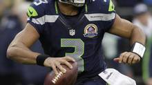In 13 NFL games, Seattle Seahawks quarterback Russell Wilson is 208-for-330 for 2,492 yards passing, 20 touchdowns and nine interceptions. He has also run 69 times for 310 yards. (ROBERT SORBO/REUTERS)