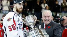 CHL Commissioner David Branch presents the CHL Memorial Cup to Harry Young #55 of the Windsor Spitfires during the 2009 Mastercard Memorial Cup Final at the Rimouski Colisee on May 24, 2009 in Rimouski, Quebec, Canada. The Spitfires defeated the Rockets 4-1 winning the 2009 Memorial Cup. (Richard Wolowicz/Getty Images)