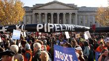 Demonstrators carry a giant mock pipeline while calling for the cancellation of the Keystone XL pipeline during a rally in Washington in this Nov. 6, 2011 file photo. (Joshua Roberts/Reuters/Joshua Roberts/Reuters)