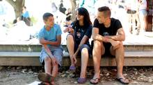 From left, Hamza Younis, Hanan Abu-Abed and Nadeem Nadeem Gazmawi chat during lunch at Camp Shomria on July 26, 2013 near Perth, Ont. Camp Shomira's Heart to Heart program brings Jewish and Palestinian Israeli youth to Canada to share their experience. (Dave Chan for the Globe and Mail)