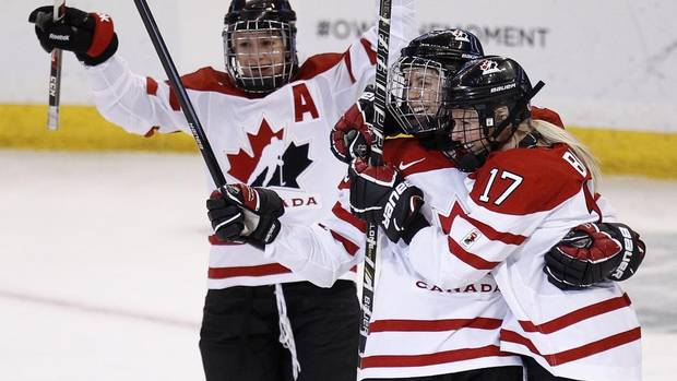 Canada's Bailey Bram (R) celebrates her goal against Finland with teammates Gillian Apps (C) and Catherine Ward during the first period of their preliminary round game at the IIHF Ice Hockey Women's World Championship in Ottawa April 5, 2013. Canada won 3-2. (CHRIS WATTIE/REUTERS)