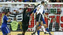 Germany's Miroslav Klose (R) scores their third goal during their Euro 2012 quarter-final soccer match against Greece at the PGE Arena in Gdansk, June 22, 2012. (KAI PFAFFENBACH/REUTERS)