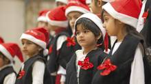 "December 15, 2011 - Surrey, BC -Harman Nijjar, grade 1, watches the christmas concert at Newton Elementary Thursday afternoon. The Parents' Council at Newton, which is made up of mostly Indo-Canadian students, decided that they will have a Christmas concert this year and call it a Christmas concert ""without any bhangra dancing."" (Brett Beadle/Brett Beadle/The Globe and Mail)"