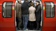 Commuters board an underground train at King's Cross station in London on April 29, 2014. (NEIL HALL/REUTERS)