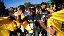 Supporters of South Africa's ruling African National Congress (ANC) party dance on February 11, 2010 during celebrations, marking the 20th anniversary of former South African President and Nobel peace prize laureate Nelson Mandela's release from jail. (GIANLUIGI GUERCIA/AFP/Getty Images)