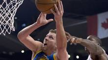 Golden State Warriors forward David Lee (left) is fouled by Toronto Raptors forward Ed Davis (back) during first half NBA action in Toronto on Monday January 28, 2013. (Frank Gunn/THE CANADIAN PRESS)