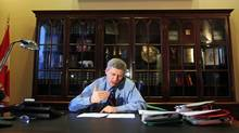Prime Minister Stephen Harper gives a radio interview in his Langevin Block office on Monday, January 18, 2010. (FRED CHARTRAND)