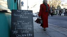 A pedestrian walks past a sign outside a cafe displaying a menu relating to the current economic climate, in Dublin November 23, 2010. The European Union urged Ireland on Tuesday to adopt an austerity budget on time to unlock promised EU/IMF funding, responding to a deepening political crisis that threatens to derail the financial rescue. (Cathal McNaughton/Reuters/Cathal McNaughton/Reuters)