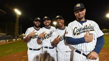 Posing for a group photo are Ismel Jimenez, left, Yordan Manduley, Alexei Bell, and Yuniesky Gurriel. Four Cuban baseball players were legally allowed to leave the country to play baseball in Canada for the Quebec Capitales. It's a new venture for Cuba, which is only now beginning to see a thaw in its relationship with the United States. (Fred Lum/The Globe and Mail)