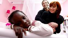 Five-year-old old Dania Dion-Lachapelle in her new room with parents Marlyne Lachapelle and Benoit Dion. Dania arrived from Haiti Sunday (Christinne Muschi/Christinne Muschi for The Globe and Mail)