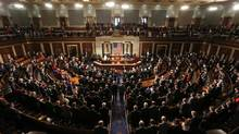 Members of the 113th U.S. Congress bow their heads in prayer as they convene in the Capitol in Washington on Jan. 3, 2013. (KEVIN LAMARQUE/REUTERS)