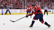 Washington Capitals winger Alex Ovechkin shoots and scores his 500th career NHL goal during the second period against the Ottawa Senators at the Verizon Center, in Washington, D.C., on Jan. 10. (Drew Hallowell/Getty Images)