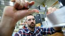 Greg Wood, 25, has come through a three-week training program with Ontario Manufacturing Learning Consortium and is now doing a 23-week training program at Cyclone Manufacturing in Mississauga, on Wednesday, November 12, 2014. (Peter Power for The Globe and Mail)