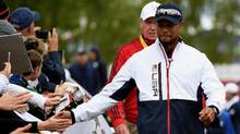 Vice-captain Tiger Woods of the United States high fives fans during practice prior to the 2016 Ryder Cup at Hazeltine National Golf Club on September 28, 2016 in Chaska, Minnesota. (Ross Kinnaird/Getty Images)