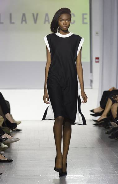 The First Look: The runway action kicked off with a presentation by Bellavance designers Nolan Bellavance and Ava Hama. The New York-based Parsons grads opened their show with what appeared to be a simple black shift. From behind, however, it revealed layers of detail – wide white bands that created an X from shoulder to hip over a grey, racer-back underdress – that set the scene for a season focused on unexpected twists. (JENNA MARIE WAKANI FOR THE GLOBE AND MAIL)