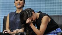Brenda Song, left, and Vanessa Lachey, cast members in the Fox series Dads, laugh during a panel discussion on the show at the Fox 2013 Summer TCA press tour at the Beverly Hilton Hotel on Thursday, Aug. 1, 2013 in Beverly Hills, Calif. (Chris Pizzello/AP)