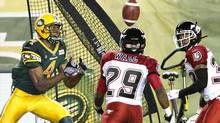 Calgary Stampeders Jamar Wall blocks the pass to Edmonton Eskimos Adarius Bowman during second half action in Edmonton, Alta., on Thursday July 24, 2014. (JASON FRANSON/THE CANADIAN PRESS)