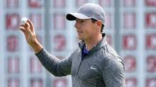 Rory McIlroy holds up his ball after finishing on the 18th hole during the final round of the Deutsche Bank Championship on Sept. 5, 2016. (Michael Dwyer/AP)