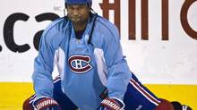 Georges Laraque stretches during a practice, Tuesday, April 14, 2009 in Brossard, Que. The drive to unionize junior-hockey players appears set for collapse, with the Laraque, the executive director of the scandal-plagued Canadian Hockey League Players' Association saying he plans to leave. (Paul Chiasson/The Canadian Press)