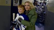 Andrea Winarski and her son, Aidan Fowler, 9, at the Markham Centennial Centre this month. 'You should see some of the comments on my Facebook,' she says of her petition to end body contact at all levels from bantam (age 14) on down. (Peter Power/The Globe and Mail)