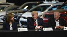 U.S. President Donald Trump delivers remarks at American Center for Mobility in Ypsilanti, Michigan with General Motors CEO Mary Barra and Dennis Williams, United Auto Workers president on March 15, 2017. (NICHOLAS KAMM/AFP/Getty Images)
