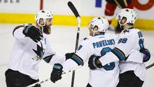 San Jose Sharks' Joe Pavelski, centre, celebrtes his game-winning goal with teammates Joe Thornton, left, and Brent Burns during overtime NHL hockey action against the Calgary Flames in Calgary, Monday, March 7, 2016. (Jeff McIntosh/THE CANADIAN PRESS)