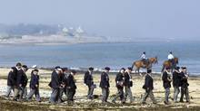 Canadian veterans make their way down Juno Beach following a ceremony marking the 60th Anniversary of D-Day in 2004. (Tom Hanson/The Canadian Press)