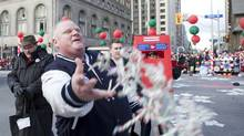 Mayor Rob Ford throws candy into the crowds during the 107th annual Santa Claus Parade (Matthew Sherwood for the Globe and Mail/Matthew Sherwood for the Globe and Mail)