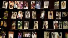 Family photographs of some of those who died hang in a display in the Kigali Genocide Memorial Centre in Kigali, Rwanda, Saturday, April 5, 2014. The country will commemorate on April 7, 2014, the 20th anniversary of the genocide that killed neighbours, friends and family during a three-month rampage of violence. (Ben Curtis/AP)