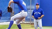 Toronto Blue Jays pitcher Casey Janssen throws from the practice mound as manager John Gibbons looks on at the team's MLB baseball spring training facility in Dunedin, Florida February 14, 2013. REUTERS/Fred Thornhill (UNITED STATES - Tags: SPORT BASEBALL) (FRED THORNHILL/REUTERS)