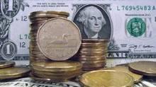 Canadian dollars shown with U.S dollar (Ryan Remiorz/THE CANADIAN PRESS)