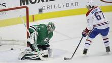 Montreal Canadiens left wing Max Pacioretty (67) scores the game winning goal against Dallas Stars goalie Kari Lehtonen (32) during overtime in an NHL hockey game in Dallas, on Jan. 4, 2017. (LM Otero/AP)