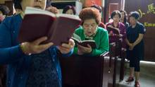 "A Sunday morning service in May at a church belonging to the state-sanctioned Three-Self Patriotic Movement, in Wenzhou, China. Many residents of this town known as ""China's Jerusalem"" for its proliferation of churches are upset by the recent demolition of the huge Sanjiang Church. (SIM CHI YIN/NYT)"