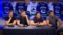 Vancouver Canucks players (left to right) Henrik Sedin, Daniel Sedin, Alex Burrows and Kevin Bieksa talk to media during the first day of the team's training camp in Vancouver, B.C., on Thursday September 18, 2014. (BEN NELMS/THE CANADIAN PRESS)