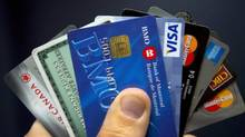 Credit cards are displayed in Montreal on December 12, 2012. (Ryan Remiorz/THE CANADIAN PRESS)