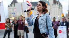 Anne-Marie Roy, president of the Student Federation of the University of Ottawa, speaks at a May Day rally in Ottawa on May 1, 2013. (BEN POWLESS/THE CANADIAN PRESS)