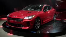 Kia Motors America unveils the 2018 Kia Stinger during the North American International Auto Show in Detroit, Sunday, Jan. 8, 2017. (David Guralnick/AP)