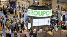 A Groupon booth is seen at the National Restaurant Association Tradeshow at McCormick Place, on Sunday, May 19, 2013 in Chicago. (John Konstantaras/AP Images for Groupon)
