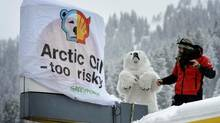 Greenpeace activists demonstrate at a Shell gasoline station near Davos, Switzerland, where the 43rd annual meeting of the World Economic Forum is taking place. (Laurent Gillieron/AP)
