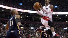 Toronto Raptors guard Terrence Ross (31) soars through the air past Indiana Pacers forwards David West (21) and Paul George (24) during first half NBA action in Toronto on April 4, 2014. (Frank Gunn/THE CANADIAN PRESS)