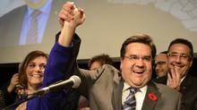 Denis Coderre celebrates after winning the mayoral election Sunday, November 3, 2013 in Montreal. (RYAN REMIORZ/THE CANADIAN PRESS)