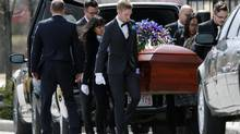 Mourners carry the casket of Lawrence Hong, 27, at a funeral ceremony in Calgary on April 23, 2014. (TODD KOROL/REUTERS)