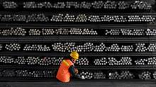 A labourer marks steel bars at a steel and iron factory in Huai'an, Jiangsu province, China, in this file photo. (PATTY CHEN/Reuters)